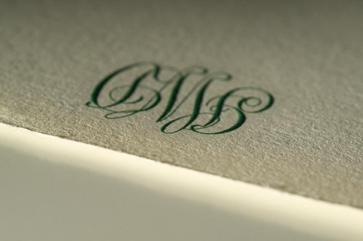 engraved green monogram