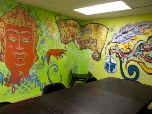 "Our locally painted murals in ""The Room"" for writers"