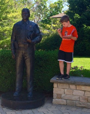 Elliot getting inspired by his new protagonist, a statue in Memorial Park.
